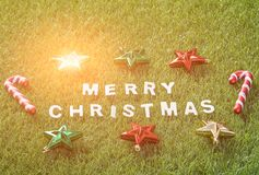 Top view Christmas alphabet and decoration on green grass Royalty Free Stock Photo