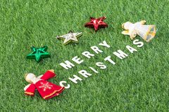 Top view Christmas alphabet and decoration on green grass. Background, Celebration of New year and Christmas Royalty Free Stock Photo