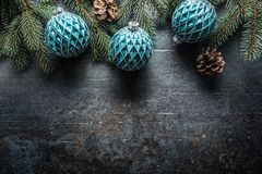 Top of view christmas balls fir tree pine cones on free concrete background stock photography