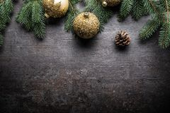 Top of view christmas balls fir tree pine cones on free concrete background stock images