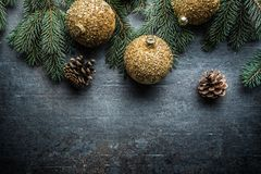 Top of view christmas balls fir tree pine cones on free concrete background royalty free stock photography