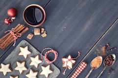 Top view on Christmas cookies, mulled wine, spices and decoratio. Christmas background in white and red on dark wood. Top view on Christmas cookies, mulled wine Royalty Free Stock Image