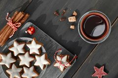Top view on Christmas cookies, mulled wine, spices and decoratio. Christmas background in white and red on dark wood. Top view on Christmas cookies, mulled wine Stock Images