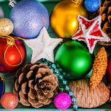 Top view of Christmas decoration, tinsel,  pinecones, stars and Royalty Free Stock Image