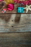 Top view of  Christmas garland on rustic wooden background Stock Photo