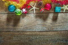Top view of  Christmas garland on rustic wooden background Royalty Free Stock Photo