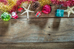 Top view of  Christmas garland on rustic wooden background with copy space. Stock Photography