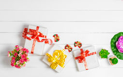 Top view Christmas Gift Box on white wooden table background, Fl Stock Photos