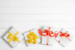 Top view Christmas Gift Box on white wooden table background, Fl Royalty Free Stock Images