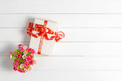 Top view Christmas Gift Box on white wooden table background, Fl Royalty Free Stock Photos