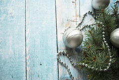 Top view of Christmas and New Year composition with decorated fur-tree branch on wooden background with place for your text Stock Photo