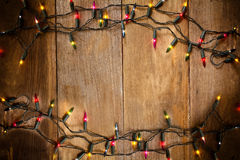 Top view, Christmas and New Year lights on old wood background Royalty Free Stock Image