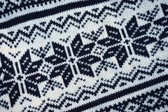 Christmas patternt white and black of knitted sweater. Wool. Knitted sweater closeup. Textile texture detailed warm yarn. Top view Christmas patternt white and stock images