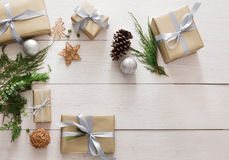 Top view of christmas present boxes on white wood Royalty Free Stock Image
