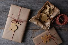 Christmas Presents with Holiday Shaped Cookies. Top view of Christmas Presents with Holiday Shaped Cookies on a rustic wood background Stock Image