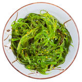 Top view of chuka salad - seaweed salad. Sprinkled with sesame seeds in bowl isolated on white background Stock Images