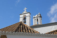 Top View of a church with stork birds in nest - Fa Stock Photos