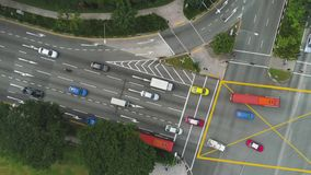 Top view of a city intersection with a bus, cars and people crossing the street. Shot. Traffic at daytime, rossroad in stock footage