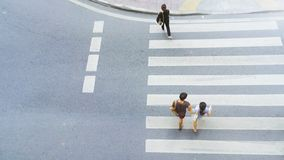 Top view of city people are walking across crosswalk in the city. Street Royalty Free Stock Photos