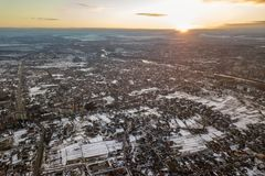 Top view of city suburbs or small town nice houses on winter morning on cloudy sky background. Aerial drone photography concept stock photo
