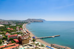 The top view on the city Sudak, Crimea, Sky and Sea. Royalty Free Stock Image