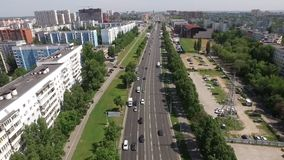Top view on city in summer day, aerial shot of road stock footage