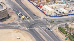 Top view city traffic on a crossroad in Dubai Downtown timelapse. Aerial top view of road junction from above, automobile traffic and jam of many cars stock video