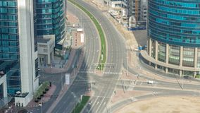 Top view city traffic on a crossroad in Dubai Downtown timelapse. Top view city traffic on a crossroad in Dubai Downtown near Business bay timelapse. Aerial top stock footage