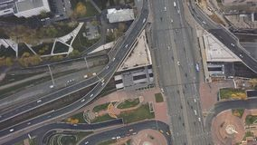 Top view city traffic of highway, logistics. Clip. Aerial top view of road junction from above, automobile traffic and. Jam of many cars, transportation concept Royalty Free Stock Photos