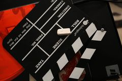 Top view at clapperboard. And a chalk at studio Stock Photo