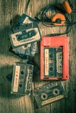 Classic audio cassette with headphones and walkman. Top view of classic audio cassette with headphones and walkman royalty free stock photography