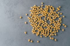 Top view of clean fresh garbanzo or chickpeas on grey background. Flat lay. Raw food for vegans. Close up. Ingredients full of. Protein royalty free stock photo