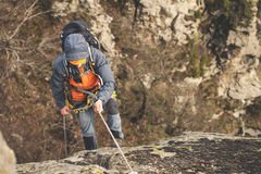 Top view, climber on rope and helmet rises on vertical rock Stock Photography