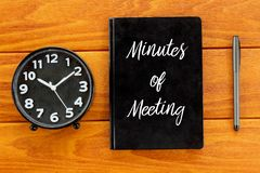 Top view of clock,pen and notebook written with Minutes of Meeting on wooden background. Business and finance concept. Top view of clock,pen and notebook vector illustration