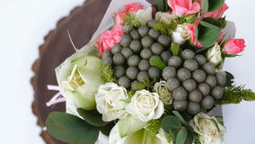 Top view, close-up of a bouquet of flowers, rotation , consists of eucalyptus, cineraria, Rose cream grace, Rose. Top view, close-up of a bouquet of flowers stock footage