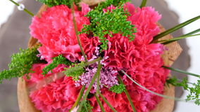 Top view, close-up of a bouquet of flowers, rotation on a white background. consists of Carnation, Barbatus. Top view, close-up of a bouquet of flowers stock video footage