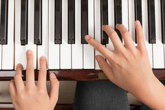 Top view close up of female hands playing piano stock images