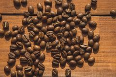 Aromatic coffee beans locating on desk Royalty Free Stock Photo