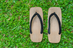 Top view close up old wooden sandal with a thick sole. Royalty Free Stock Photo
