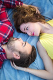 Top view close up portrait of beautiful couple lying on blanket Royalty Free Stock Image
