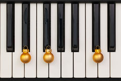 Top view close up shot of piano keyboard and Christmas decoration Royalty Free Stock Images