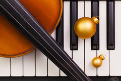 Top view close up shot of piano keyboard,old violin and Christma Stock Image