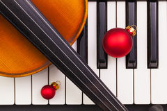 Top view close up shot of piano keyboard,old violin and Christma Royalty Free Stock Photo