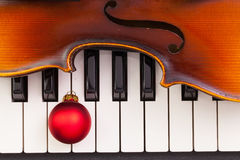 Top view close up shot of piano keyboard,old violin and Christma Stock Photos