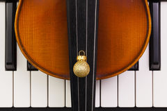 Top view close up shot of piano keyboard,old violin and Christma Royalty Free Stock Image