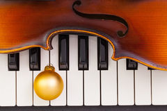 Top view close up shot of piano keyboard,old violin and Christma Stock Images