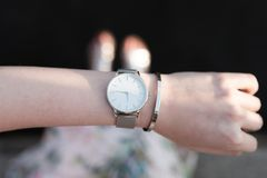 Top view of wristwatch on arm of woman Stock Images