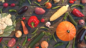 Vegetable mix on the table. Top view. Close up. The smooth glide of the camera  from right to left  along the old village table with a variety of vegetables stock footage