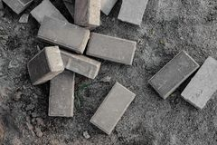 Top view close up texture background of some building bricks. Top view close up texture background of some grey building bricks arranged on the dusty grey ground stock images