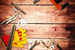 Top view close up of variety handy tools on wood background with copy space for your text for Worker`s day, labour`s day backgroun stock image